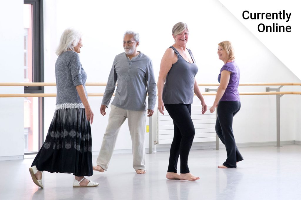 A man and three women wearing casual clothes standing in a dance studio smiling with the words 'Currently online'..