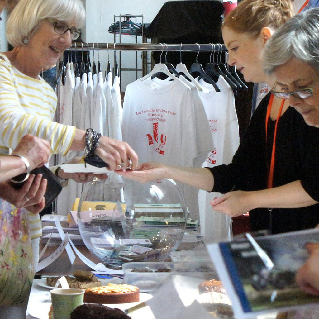 A woman making a purchase at a fundraising event.